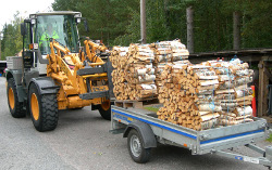 Loading firewood on trailer 3
