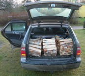 Firewood bundles in trunk of a car 1