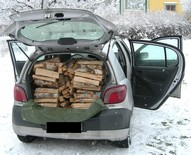 Firewood bundles in car