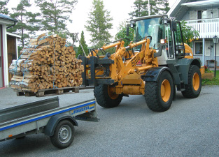 Loading firewood on trailer