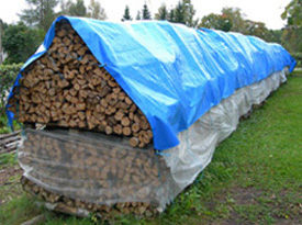 Storing firewood under tarpaulins